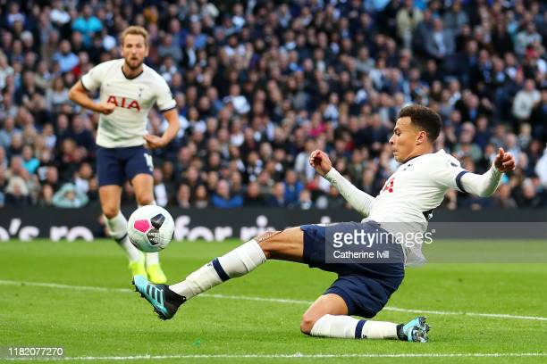 Dele Alli of Tottenham Hotspur scores his team's first goal during the Premier League match between Tottenham Hotspur and Watford FC at Tottenham...