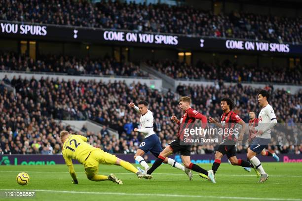 Dele Alli of Tottenham Hotspur scores his team's first goal during the Premier League match between Tottenham Hotspur and AFC Bournemouth at...