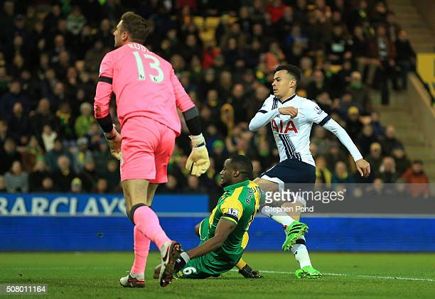 Dele Alli of Tottenham Hotspur scores his team's first goal during the Barclays Premier League match between Norwich City and Tottenham Hotspur at...