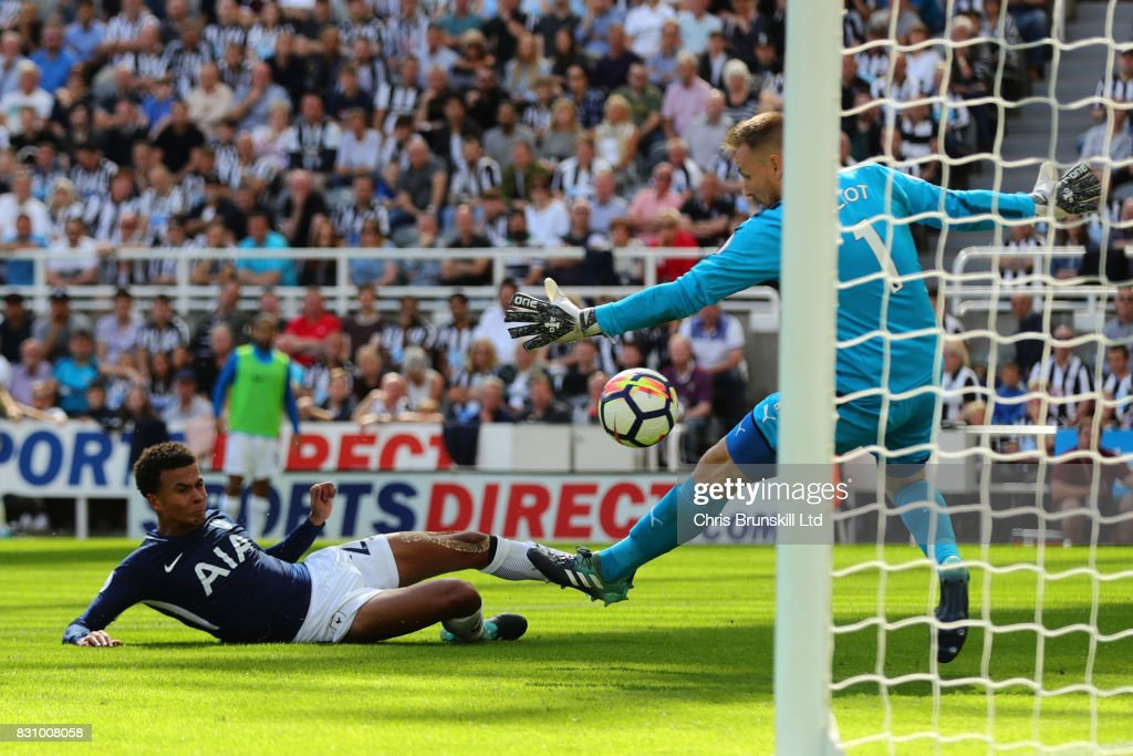 Dele Alli of Tottenham Hotspur scores his team's first goal during the Premier League match between Newcastle United and Tottenham Hotspur at St. James' Park on August 13, 2017 in Newcastle upon Tyne, England.