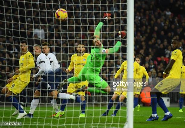 Dele Alli of Tottenham Hotspur scores his team's first goal past Kepa Arrizabalaga of Chelsea during the Premier League match between Tottenham...