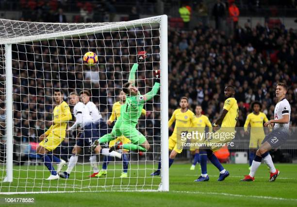 Dele Alli of Tottenham Hotspur scores his team's first goal past Kepa Arrizabalaga of Chelsea during the Premier League match between Tottenham...