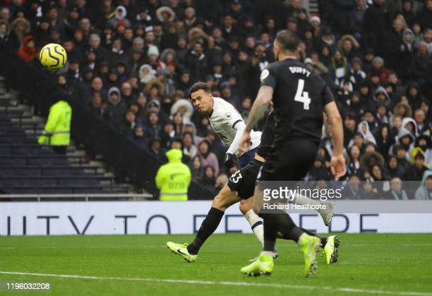 Dele Alli of Tottenham Hotspur scores his teams second goal during the Premier League match between Tottenham Hotspur and Brighton Hove Albion at...