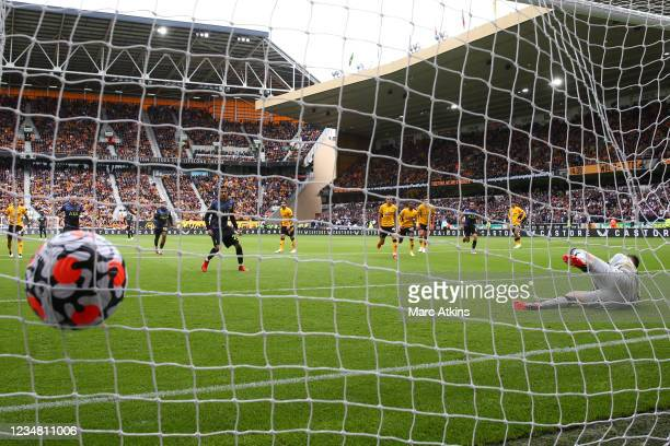 Dele Alli of Tottenham Hotspur scores the opening goal from the penalty spot during the Premier League match between Wolverhampton Wanderers and...