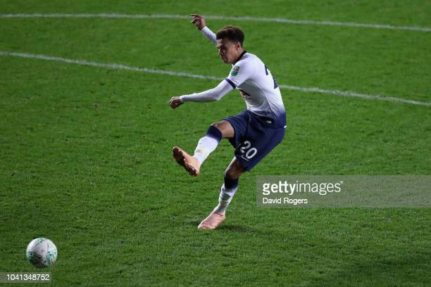 Dele Alli of Tottenham Hotspur scores their final penalty in their victory on penalties during the Carabao Cup Third Round match between Tottenham...