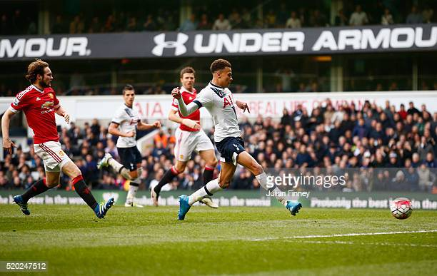Dele Alli of Tottenham Hotspur scores their first goal during the Barclays Premier League match between Tottenham Hotspur and Manchester United at...
