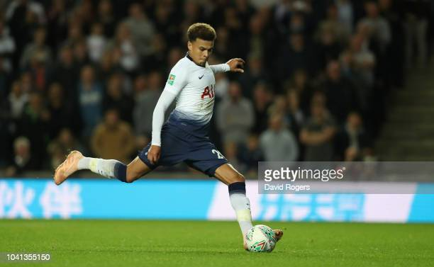 Dele Alli of Tottenham Hotspur scores their first goal from a penalty during the Carabao Cup Third Round match between Tottenham Hotspur and Watford...