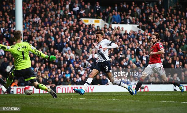 Dele Alli of Tottenham Hotspur scores their first goal past David De Gea of Manchester United during the Barclays Premier League match between...