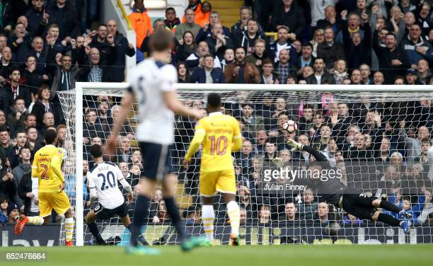 Dele Alli of Tottenham Hotspur scores their fourth goal with team mates during The Emirates FA Cup QuarterFinal match between Tottenham Hotspur and...
