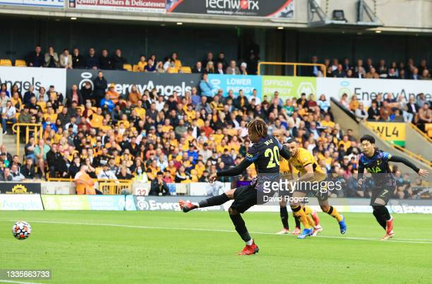 Dele Alli of Tottenham Hotspur scores their side's first goal from the penalty spot during the Premier League match between Wolverhampton Wanderers...