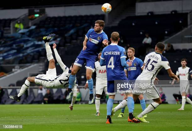 Dele Alli of Tottenham Hotspur scores their team's first goal with a overhead kick during the UEFA Europa League Round of 32 match between Tottenham...