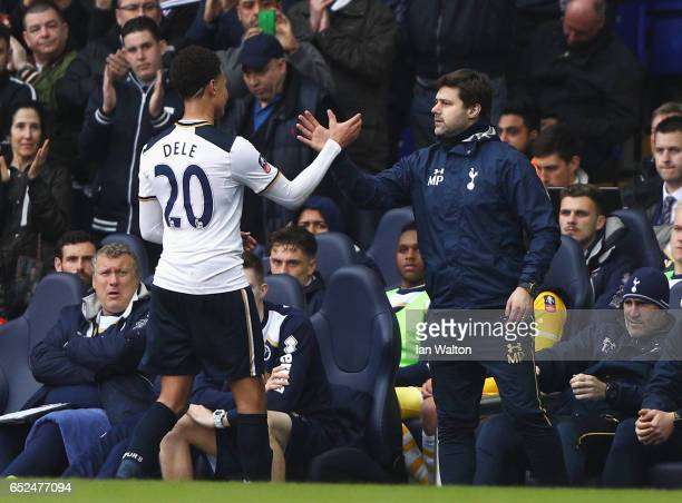 Dele Alli of Tottenham Hotspur shakes hand with Mauricio Pochettino manager of Tottenham Hotspur as he is substituted during The Emirates FA Cup...