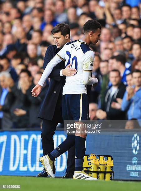 Dele Alli of Tottenham Hotspur shakes hands with his manager Mauricio Pochettino Manager of Tottenham Hotspur after being subbed during the Premier...