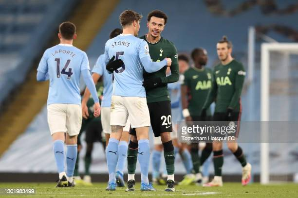 Dele Alli of Tottenham Hotspur shakes hands with John Stones of Manchester City following the Premier League match between Manchester City and...