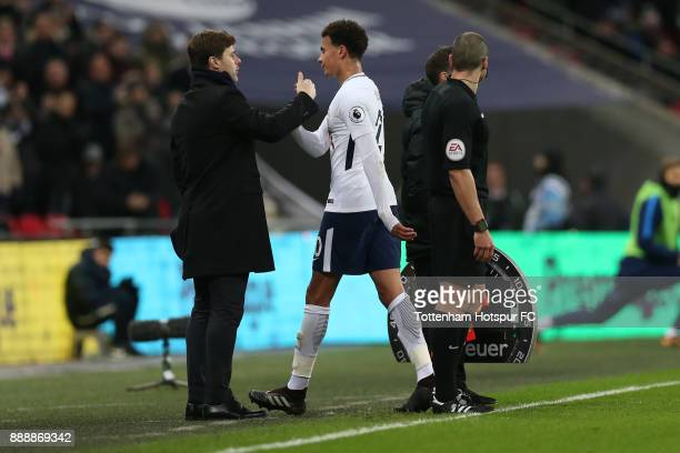 Dele Alli of Tottenham Hotspur shakes hands with Mauricio Pochettino Manager of Tottenham Hotspur as he is subbed during the Premier League match...