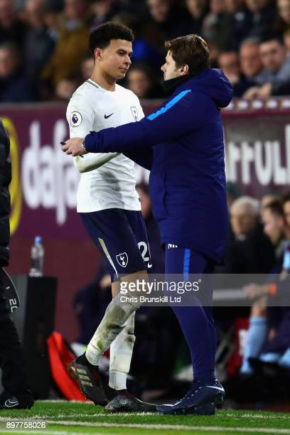Dele Alli of Tottenham Hotspur shakes hands with Mauricio Pochettino Manager of Tottenham Hotspur after being substituted during the Premier League...