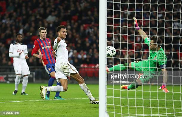 Dele Alli of Tottenham Hotspur shoots and Igor Akinfeev of CSKA Moscow turns it into his own net for Tottenham Hotspurs fourth goal uring the UEFA...