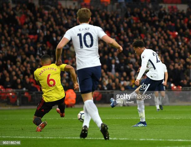Dele Alli of Tottenham Hotspur shoots and scores his side's first goal during the Premier League match between Tottenham Hotspur and Watford at...