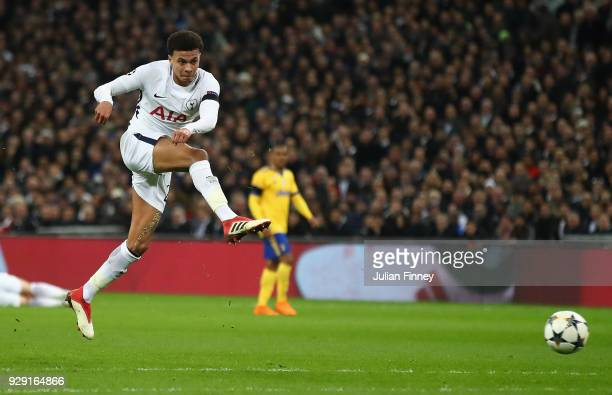 Dele Alli of Tottenham Hotspur shoots at goal during the UEFA Champions League Round of 16 Second Leg match between Tottenham Hotspur and Juventus at...