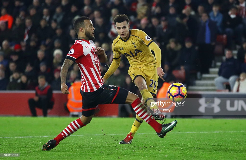 Dele Alli of Tottenham Hotspur shoots past Ryan Bertrand of Southampton as he scores theor fourth goal during the Premier League match between Southampton and Tottenham Hotspur at St Mary's Stadium on December 28, 2016 in Southampton, England.