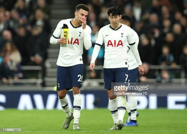 Dele Alli of Tottenham Hotspur speaks to Heung-Min Son of Tottenham Hotspur during the Premier League match between Tottenham Hotspur and Liverpool...