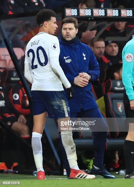Dele Alli of Tottenham Hotspur speaks to Mauricio Pochettino as he leaves the game through injury during the Premier League match between AFC...