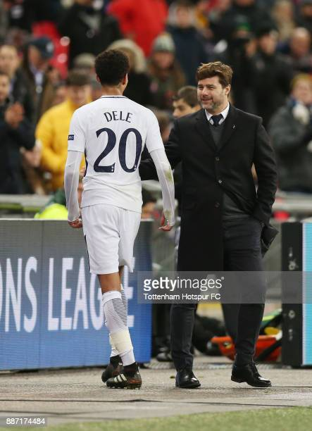 Dele Alli of Tottenham Hotspur speaks to Mauricio Pochettino Manager of Tottenham Hotspur after the UEFA Champions League group H match between...