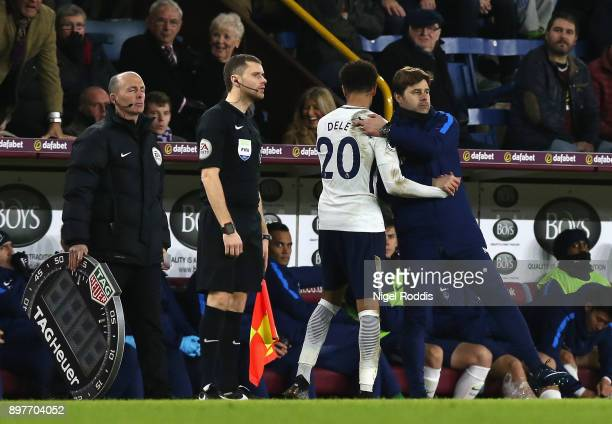 Dele Alli of Tottenham Hotspur speaks with Mauricio Pochettino Manager of Tottenham Hotspur after he is subtituted during the Premier League match...