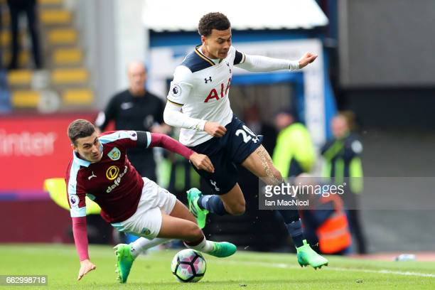 Dele Alli of Tottenham Hotspur takes the ball past Matthew Lowton of Burnley during the Premier League match between Burnley and Tottenham Hotspur at...