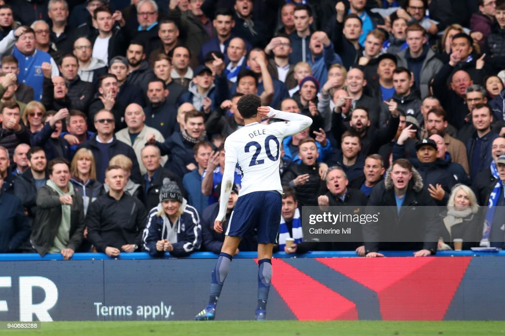 Dele Alli of Tottenham Hotspur taunts the Chelsea fans as he celebrates scoring his sides second goal during the Premier League match between Chelsea and Tottenham Hotspur at Stamford Bridge on April 1, 2018 in London, England.