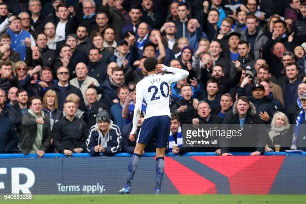 Dele Alli of Tottenham Hotspur taunts the Chelsea fans as he celebrates scoring his sides second goal during the Premier League match between Chelsea...
