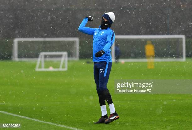 Dele Alli of Tottenham Hotspur throws a snowballs during a Tottenham Hotspur Training Session on December 11 2017 in Enfield England