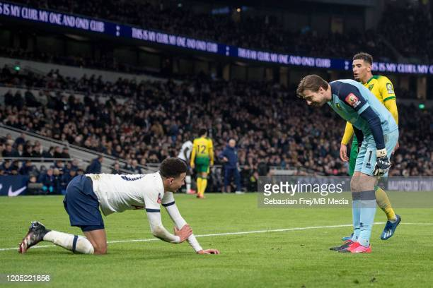 Dele Alli of Tottenham Hotspur Tim Krul and Ben Godfrey of Norwich City reacts during the FA Cup Fifth Round match between Tottenham Hotspur and...