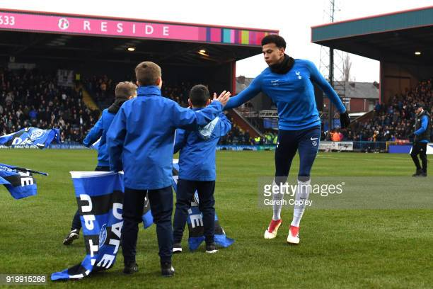 Dele Alli of Tottenham Hotspur warms up during The Emirates FA Cup Fifth Round match between Rochdale and Tottenham Hotspur on February 18 2018 in...