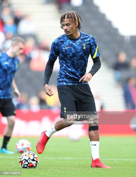 Dele Alli of Tottenham Hotspur warms up prior to the Pre-Season Friendly match between Milton Keynes Dons and Tottenham Hotspur at Stadium mk on July...