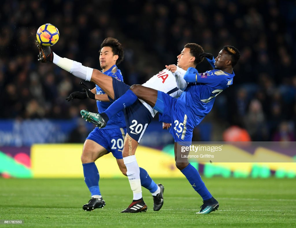 Dele Alli of Tottenham Hotspur wins the ball under pressure from Shinji Okazaki and Wilfred Ndidi and of Leicester City during the Premier League match between Leicester City and Tottenham Hotspur at The King Power Stadium on November 28, 2017 in Leicester, England.