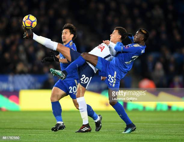 Dele Alli of Tottenham Hotspur wins the ball under pressure from Shinji Okazaki and Wilfred Ndidi and of Leicester City during the Premier League...