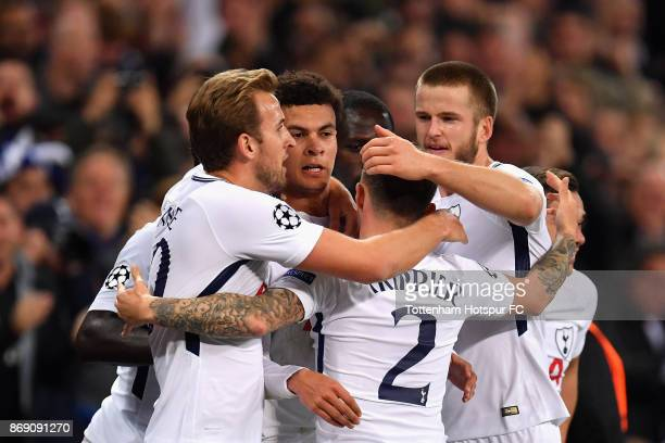 Dele Alli of Tottenham Hotspurc celebrates scoring his side's first goal with team mates during the UEFA Champions League group H match between...