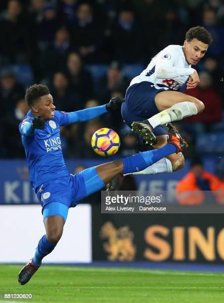 Dele Alli of Tottenham Hotspuris tackled by Demarai Gray of Leicester City during the Premier League match between Leicester City and Tottenham...