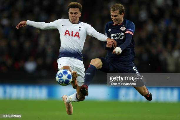 Dele Alli of Tottenham is challenged by Daniel Schwaab of PSV during the Group B match of the UEFA Champions League between Tottenham Hotspur and PSV...