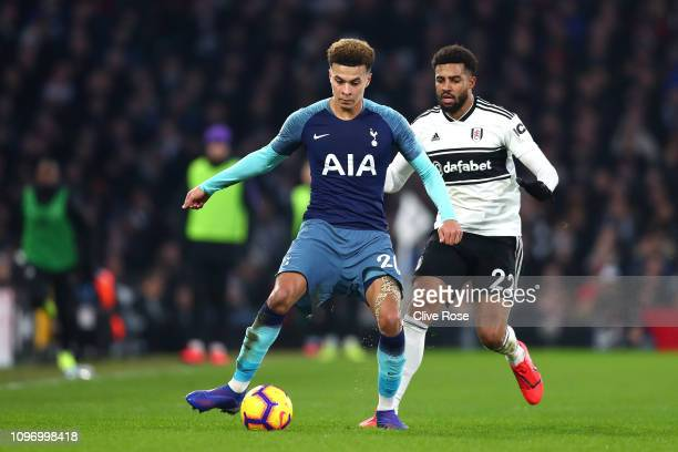 Dele Alli of Tottenham is closed down by Cyrus Christie of Fulham during the Premier League match between Fulham FC and Tottenham Hotspur at Craven...