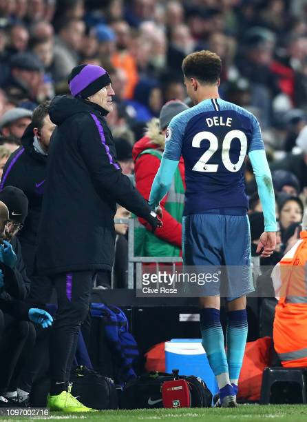 Dele Alli of Tottenham leaves the pitch following an injury during the Premier League match between Fulham FC and Tottenham Hotspur at Craven Cottage...