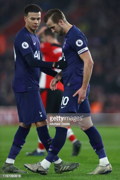 Dele Alli of Tottenham looks on as Harry Kane walks off after injuring his hamstring during the Premier League match between Southampton FC and...