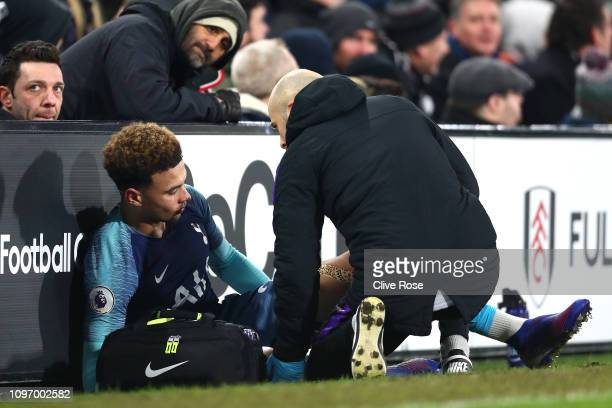 Dele Alli of Tottenham reacts to an injury during the Premier League match between Fulham FC and Tottenham Hotspur at Craven Cottage on January 20...
