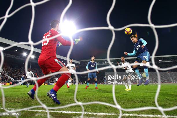 Dele Alli of Tottenham scores his sides first goal during the Premier League match between Fulham FC and Tottenham Hotspur at Craven Cottage on...