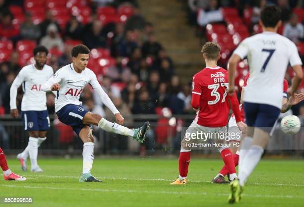 Dele Alli of Tottenham shoots at goal during the Carabao Cup Third Round match between Tottenham Hotspur and Barnsley at Wembley Stadium on September...