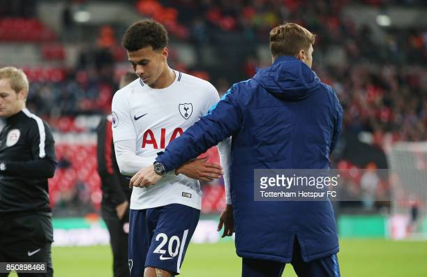Dele Alli of Tottenham with manager Mauricio Pochettino after being substituted during the Carabao Cup Third Round match between Tottenham Hotspur...