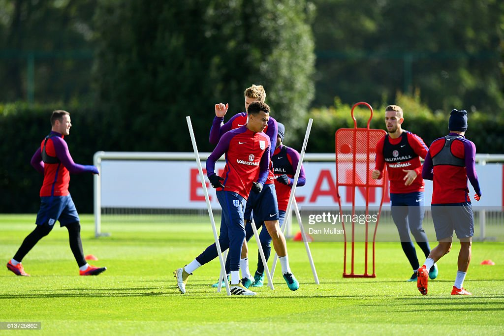 Dele Alli runs during an England training session at the Tottenham Hotspur training ground on October 10, 2016 in Enfield, England.