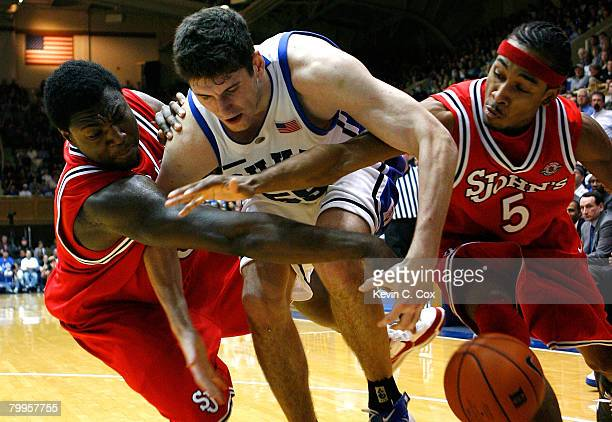 Dele Coker and Larry Wright of the St John's Red Storm battle for a steal against Brian Zoubek of the Duke Blue Devils during the second half at...