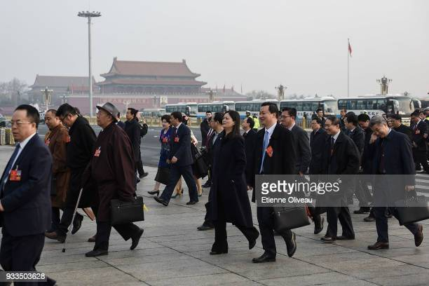 Delegate arrive to attend the sixth plenary session of the National People's Congress at the Great Hall of the People on March 18 2018 in Beijing...